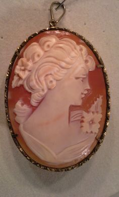 Price reduced! RARE antique cameo genuine carved shell gold plated sterling silver Roman goddess brooch/pendant by SyrinxAsylumArts on Etsy https://www.etsy.com/listing/238563015/price-reduced-rare-antique-cameo-genuine
