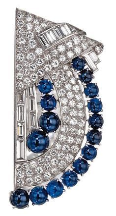 An Art Deco sapphire and diamond brooch, circa 1925. #brooch