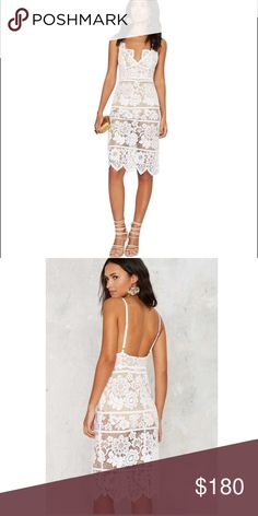For Love and Lemons Gianna White Lace Dress Lace down, class up. The Gianna Dress comes in sheer lace and features embroidered floral detailing throughout, thin adjustable shoulder straps, scalloped V-neckline and hem, hidden back zip and hook closure, bodycon midi silhouette, and beige bodysuit with snap closure.    *Cotton/Nylon/Spandex   *Runs true to size   *Dry clean only   *Imported For Love and Lemons Dresses Midi