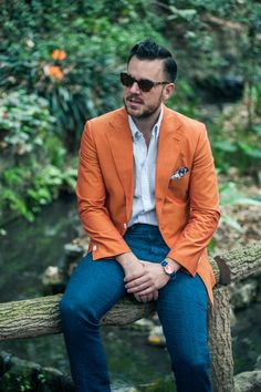 Orange blazer, blue pants