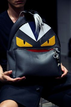Cartoon eyes leather and skin bag backstage at Fendi SS15, Milan menswear. More images here: http://www.dazeddigital.com/fashion/article/20450/1/fendi-ss15