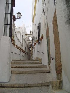 Calle de la Cuna (Cradle Street) in the white village of Arcos de la a Frontera, Cadiz, Andalucia. This street is the site of the ancient Jewish quarter. As the province of Cadiz was one of the places that the Inquisition first started, Jewish history is more difficult to trace in this area. The community's synagogue was believed to have been located on this street and in 1490, The Duchess of Arcos, Doña Beatrice Pacheco (said to have been the granddaughter of a rabbi) transformed the…