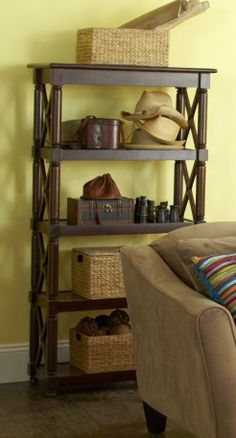 """A bookshelf doesn't have to be all about books"" --so says Pier 1. I've never been able to do decorative bookshelves with knickknacks because my bookshelves serve a purpose. I do like the shelf though."