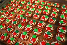pretzel hugs - pretzel squares with hershey's hugs, bake 200F for about 6-7 mins, remove from oven, add M&Ms and set in fridge to cool.