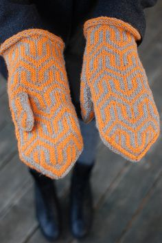 This pair of stranded colorwork mittens start with a Latvian braid and feature a bold design reminiscent of the Mod designs of the The colors are reversed on the palm for added interest. Knitted Mittens Pattern, Knit Mittens, Knitted Gloves, Knitting Socks, Knitting Machine Patterns, Knitting Charts, Wrist Warmers, Fair Isle Knitting, Double Knitting