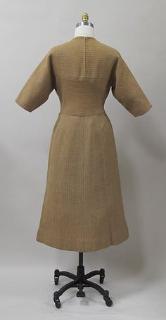 Dress...Charles James  (American, born Great Britain, 1906–1978) Date: early 1950s Culture: American Medium: wool Credit Line: Purchase, Costume Institute Benefit Fund, Friends of The Costume Institute Gifts, and Acquisitions Fund, 2013 Accession Number: 2013.317
