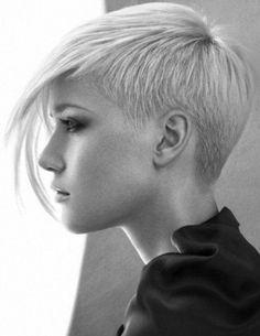 Short half shaved style with long fringe
