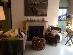 Bath showroom, with stunning driftwood table and comfty reading chair @The Salcombe Trading Company