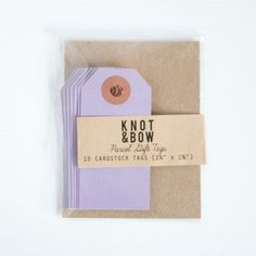 Purple parcel tags by Knot & Bow