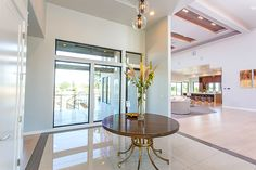 Beautiful 16' entry way features 2'x4' marble tile and an immediate view of the Rock Creek Canyon. © Jason Lugo
