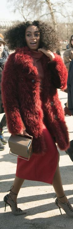 Paris Fashion Week Street Style: Solange Knolwes wearing a red furry Carven coat and lace up sandals at PFW