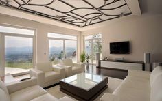 A hillside home sports a Faux Iron Grille on it's ceiling, setting off the room.