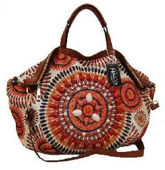 Tribal Sunburst Shoulder Bag ..  now if you are going to buy me a purse.. buy me one I like :) This one is ORANGE and peachy keen!   you know i was sad when style.ly went away... really sad. i do NOT like shopify one bit