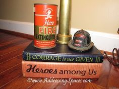 Close-up of the lamp base created using vintage fire extinguisher can, firehose nozzle, books and a fun helmet.