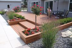 Deck planter boxes with tree form rose, boxwood hedge annuals and ornamental grass. Designed and installed in Howell Michigan by Frank Spiker of All Natural Landscapes.