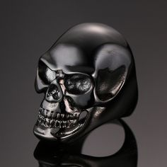 This is a unique and wonderful high polish black skull stainless steel ring. The quality feel is unique and totally amazing. Size: Multiple sizes Lenght: Material: Stainless Steel (nickel free, lead f