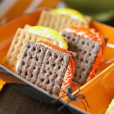 Halloween Smores. I never thought of using chocolate graham crackers!!