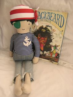 black apple doll turned into to boy pirate