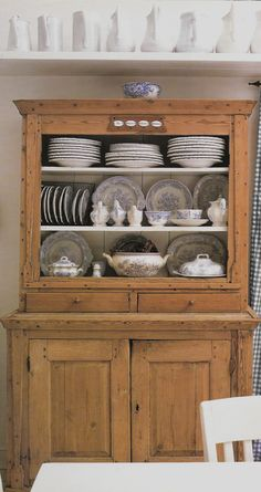 Country Hutch With Blue And White Dishes