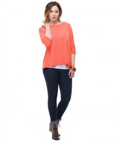 your PURE DOLMAN TOP - Coral. UPF 50+ sun protection meets style!