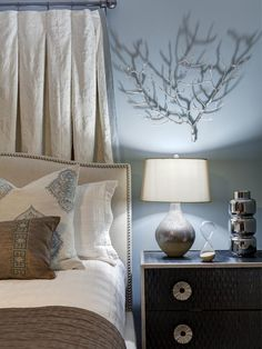 The carved texture of the mango wood nightstand creates visual interest in this bedroom.  http://www.hgtv.com/designers-portfolio/room/romantic/bedrooms/7753/index.html#/id-6651/room-bedrooms?soc=pinterest