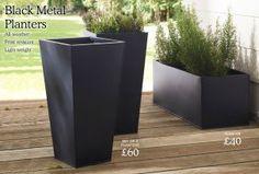 Buy Dark Grey Set Of 2 Metal Planters from the Next UK online shop