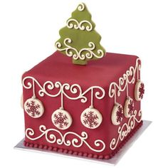 Decked Out for the Holidays Christmas Cake - Majestic scrolls cover the sides of the fondant cake and the cookie tree topper to create a joyful holiday dessert. Snowflake-covered cookie ornaments decorate the sides. Christmas Cake Designs, Christmas Cake Decorations, Christmas Sweets, Holiday Cakes, Noel Christmas, Christmas Goodies, Christmas Desserts, Christmas Baking, Christmas Cakes