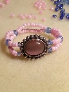 pink and blue beaded stretch ring with antiqued pink focal-$8