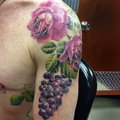 Realistic purple roses with a beautiful cluster of grapes! Artwork by Caryl Cunningham
