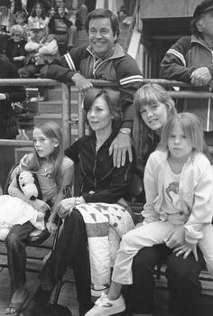 ONE BIG HAPPY FAMILY. Robert Wagner attends a sporting event with wife Natalie Wood their family