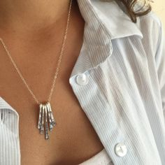 A personal favorite from my Etsy shop https://www.etsy.com/listing/255978492/silver-fringe-necklace-small-bar