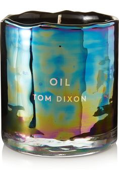 Tom Dixon's 'Materialism Oil' candle is housed in a unique glass vessel that's melted, dented and glazed to create the effect of petrol on water or light reflecting off a dragonfly's wing - no two are the same. It's scented with a powerful blend of woody essential oils, including smoky Cypress and Guaiacwood, with base notes of Pine and Styrax. We think it will make the perfect housewarming gift.