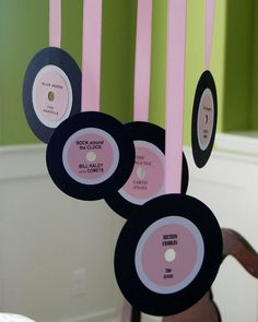 Cute hangings for Rock n Roll girls bday party - construction paper records hanging from pink streamers