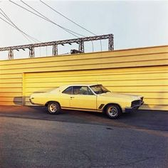 yellow parked car -William Eggleston
