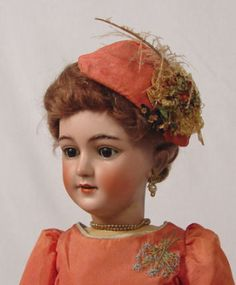 SIMON & HALBIG GERMAN BISQUE FASHION DOLL: Bisque head with molded brows, hand painted brows and lashes, pierced ears, open mouth with 4 teeth. Fully jointed body, elaborate hand sewn costume. 28'' h. Back of her head is marked Simon & Halbig 11. Please call for condition.
