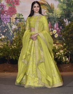 You can be assured to make a great style statement with this lime green thai silk lehenga. This lehenga is enhanced with embroidery work all over.Buy this latest designer lehenga choli online .Paired with matching choli and net dupatta Green Lehenga, Indian Lehenga, Lehenga Choli Online, Bridal Lehenga Choli, Party Wear Lehenga, Party Wear Dresses, Wedding Dresses, Wedding Hijab, Wedding Ceremony