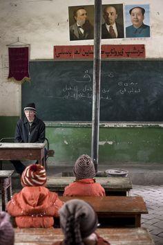 TASHKORGAN. Engels, Lenin and Mao preside over a primary school classroom. Carlos Spottorno