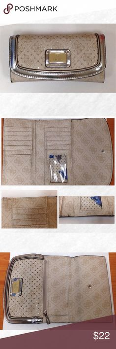 Guess Wallet Used Guess trifold wallet. Snap closure, back zipper coin pocket, 12 credit card holders, ID holder with window, and 3 cash money slots. Excellent used condition! Only flaws are on the inside, where the wallet folds, there are cracks in the leather. Shown in bottom pictures of the second picture. Guess Bags Wallets