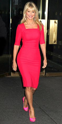 CHRISTIE BRINKLEY  Contrasting her curve-hugging hot red sheath with neon pink pumps, the model gives the color wheel a whirl outside the Today show in N.Y.C.