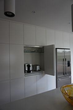 Bi-fold sliding doors leading into appliance area or Coffee making area -
