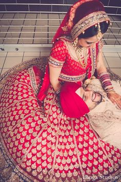 Indian bride wearing bridal lehenga and jewelry. Indian Wedding Couple, Indian Bride And Groom, Wedding Couple Poses, Big Fat Indian Wedding, Desi Wedding, Indian Bridal, Wedding Couples, Punjabi Wedding, Indian Weddings