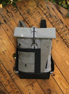 Gray & blue upcycled roll top backpack using lapel and trousers from a men's fine striped suit , by 'Eating the Goober' Top Backpacks, Blue Grey, Gray, Bradley Mountain, Upcycle, Trousers, Suit, Trending Outfits, Unique Jewelry