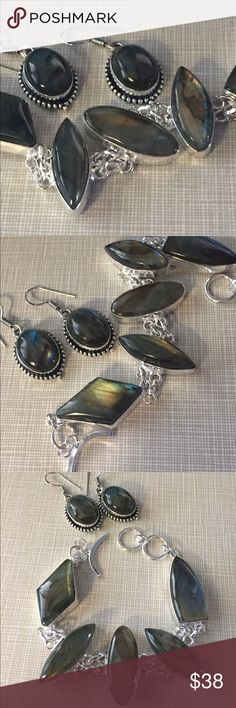 """Beautiful fire labradorite set Beautiful fire labradorite set earrings and bracelet adjustable artisan handcrafted fits up to size 8 wrists silver inlay stamped 925 earrings are approximately 1""""3/4 long also stamped Nwot Jewelry Bracelets"""