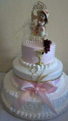 Pastel para bautizo de niña.. betún rosa y blanco muy vintage