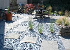 No edges...slate chippings and paving slabs