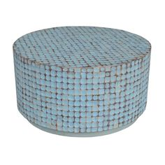 Perfectly combing natural appeal with contemporary flair, this Eco-friendly table will instantly upgrade any interior space. Crafted with coconut chips, this blue coffee table will upgrade any home decor.