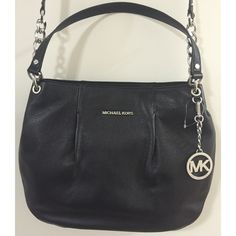 """NWOT Michael Kors Black Bedford Bag Michael by Michael Kors Bedford large convertible shoulder bag. New without tags. Excellent condition. Black, pebbled leather. Zip closure. Silver tone hardware. Handles with 8.5"""" & 21"""" drops of which the latter is adjustable. Approximate measurements in inches: 16L x 12H x 2W. Beautiful insides with 4 open pockets & one zippered pocket. MK honeycomb black lining. Care card included. No dust bag. NO TRADES. Michael Kors Bags"""