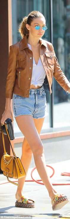 Stepping out: The fashionista completed her look with a tan leather jacket, a…