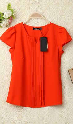 Red-Orange pleated cap sleeve blouse. Get a free scarf and 50% off jewelry in…