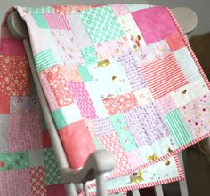 Cluck Cluck Sew: Posy Squared; a cute version of basic disappearing 9-patch, includes a link to tutorial and fabric requirements for crib size